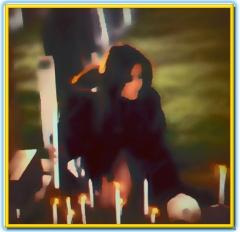 woman performs a cemetery satanic ritual